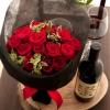 真紅のバラと赤ワインで